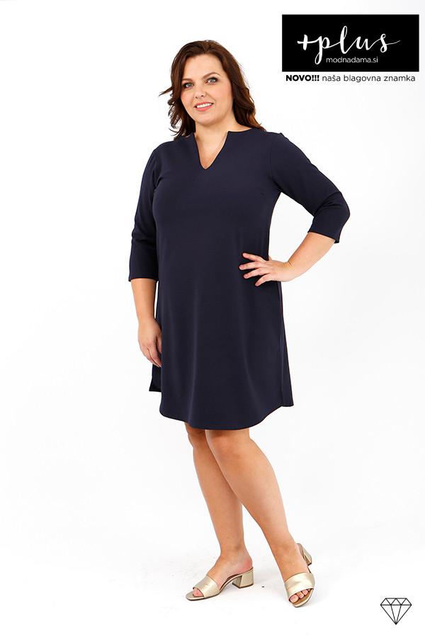 Ženska mornarsko modra obleka večjih velikosti iz raztegljivega jerseya, ki se lahko nosi tudi kot tunika.